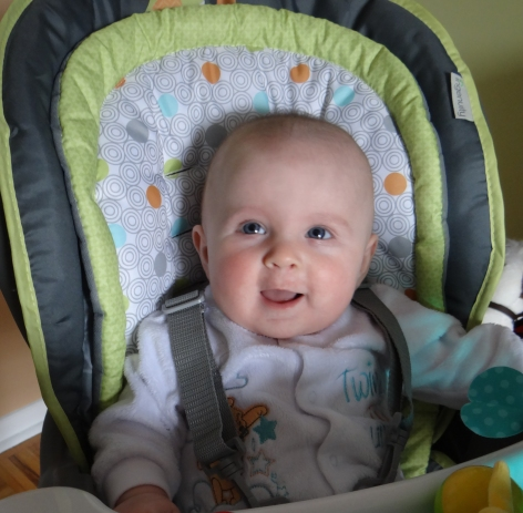 Baby sitting in high chair