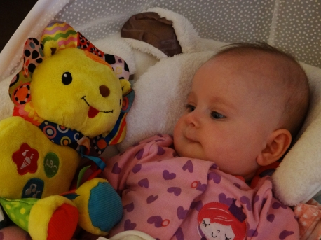 Baby with Vtech crinkle and roar lion toy