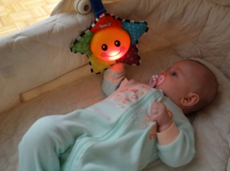 Baby playing with Baby Einstein Star Bright Symphony