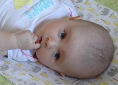 Baby sucking on her finger