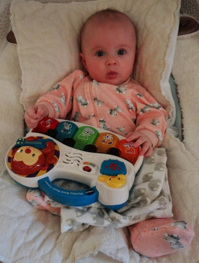 Baby with the Vtech Monkey Band Music Center