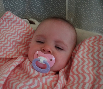 Baby having a nap with a pacifier