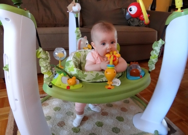 Peachy using the Evenflo ExerSaucer Jump and Learn Safari Friends.