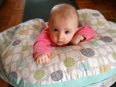 Tummy time with the use of a nursing pillow.
