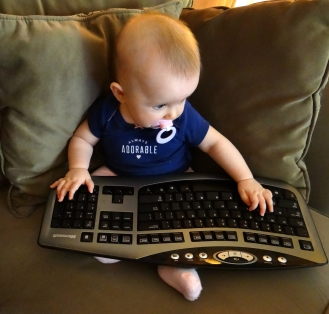Blogging baby using a keyboard
