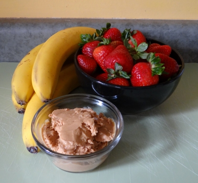 Organic bananas, strawberries, and peanut butter