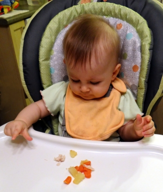 Baby self feeding with the pincer grasp