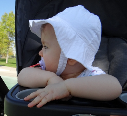Baby in a stroller enjoying the outdoors