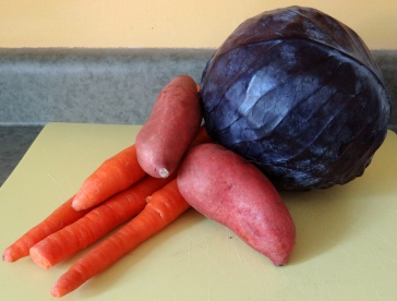 Organic purple cabbage, sweet potato, and carrot
