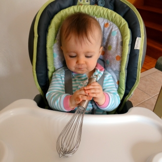 Baby with a whisk