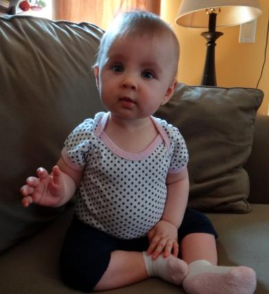 Baby waving her hand