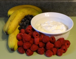 Organic banana, raspberry, blueberry, and Greek yogurt