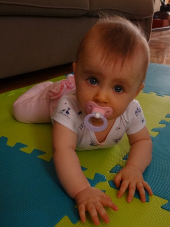 Baby learning to crawl on tummy