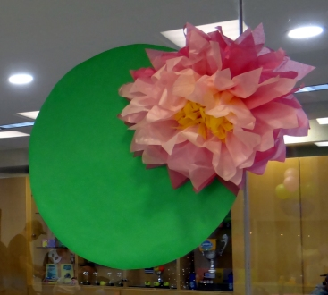 Lily pad and flower birthday party decorations made out of tissue paper