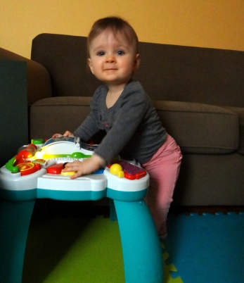 Baby standing at a play table
