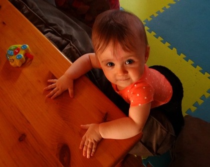 Baby standing while holding the coffee table