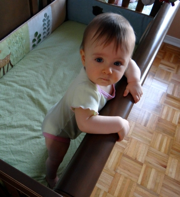 Baby standing in a crib