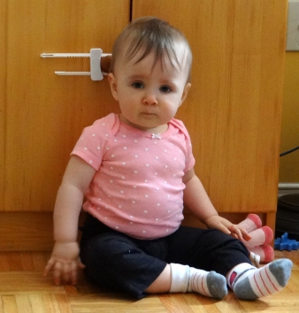 Baby girl sitting on the floor