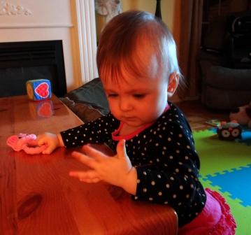 Baby girl examining her hands