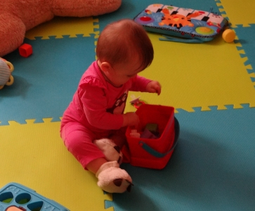 Baby playing in a baby proof area