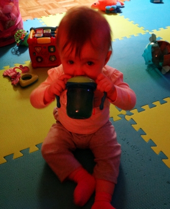 Baby drinking from a sippy cup