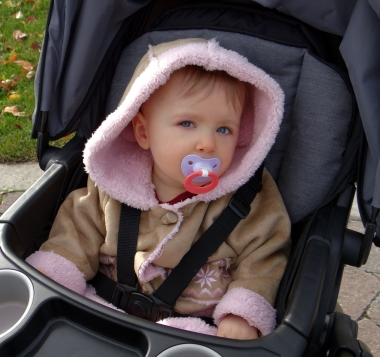 Baby wearing a jacket ready for outdoor winter fun