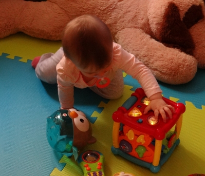 Baby playing with a Vtech toy.