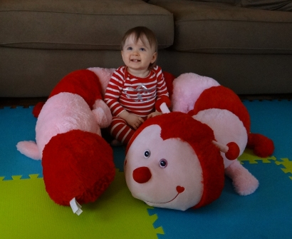 Baby with a giant stuffed caterpillar for Valentine's Day