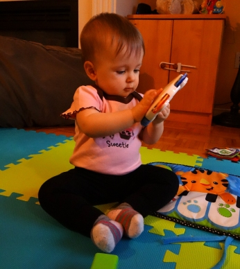 Baby playing with infant toys