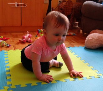 Baby practicing crawling
