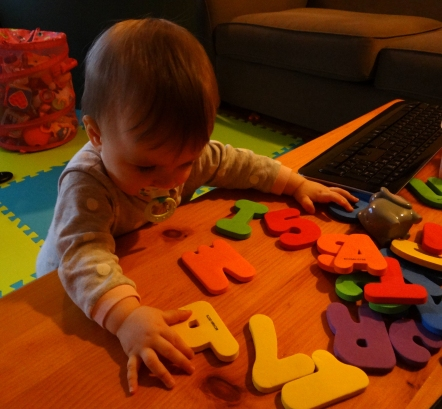 Baby playing with foam letters
