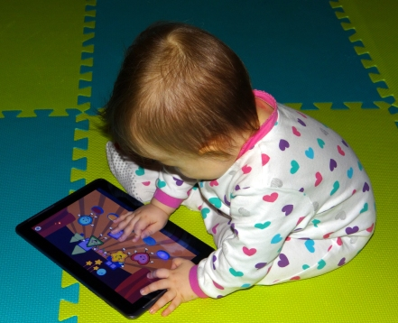 Baby playing a game on a Samsung tablet