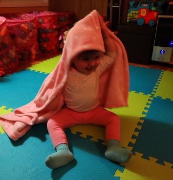 Baby girl playing Peekaboo