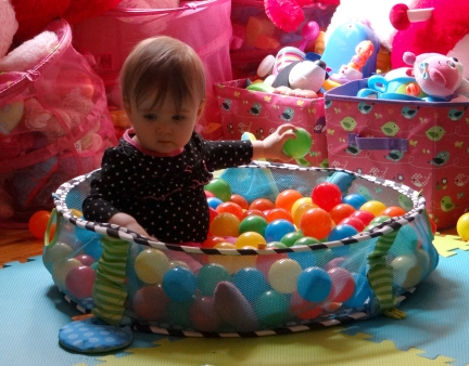 Baby playing in a ball pit