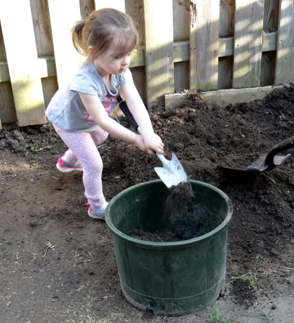 Toddler digging in the yard